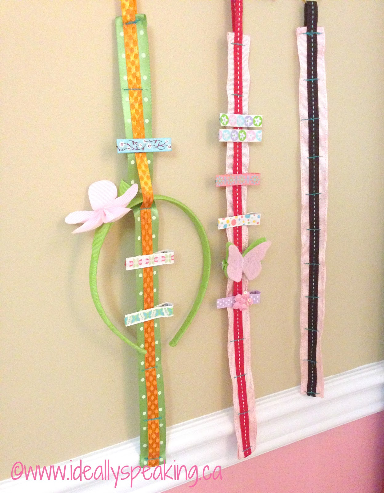Adorable DIY ribbon hangers to organize your little girl's hair accessories. Put the cute stuff on display!