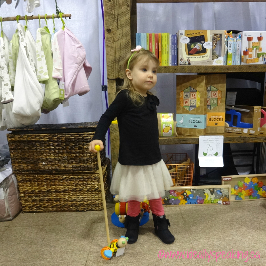 Exploring the toys at Simply Green Baby booth at Toronto BabyTime Show