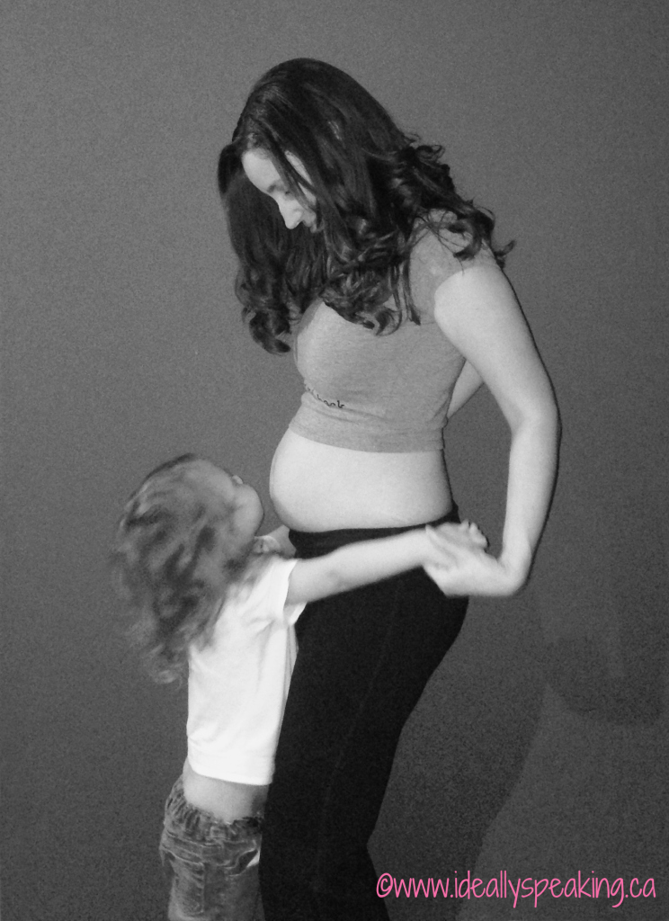 Toddler + baby belly is too cute!