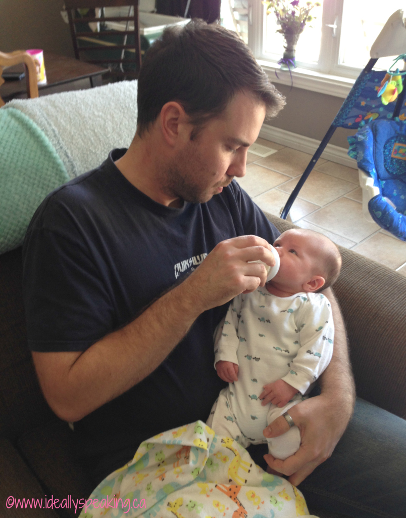 Sexy husband feeding adorable baby = winning combination every single time.