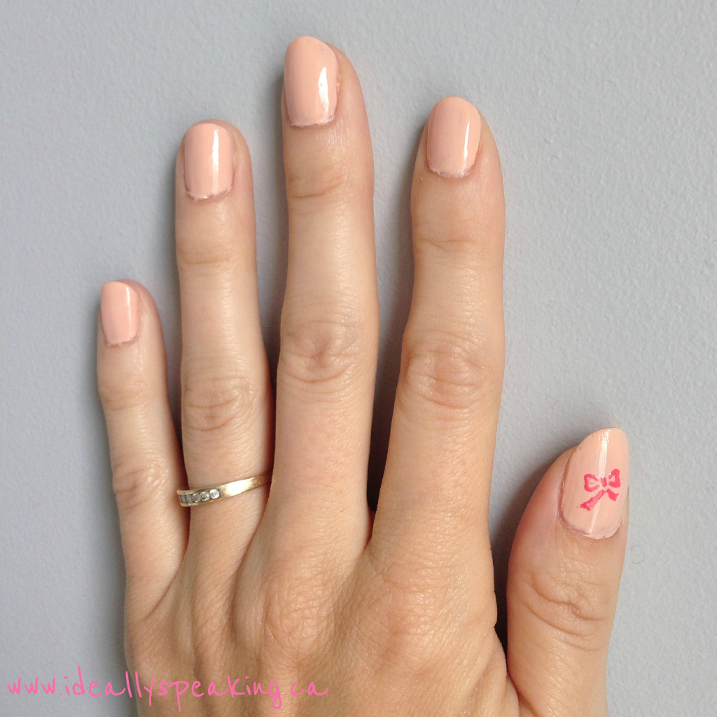 Pretty nude nails with accent nail! The bow is adorable!