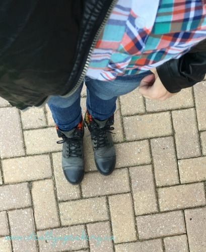 Plaid shirt with combat boots.