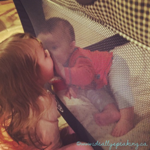 Kisses through the playpen. So adorable it hurts.