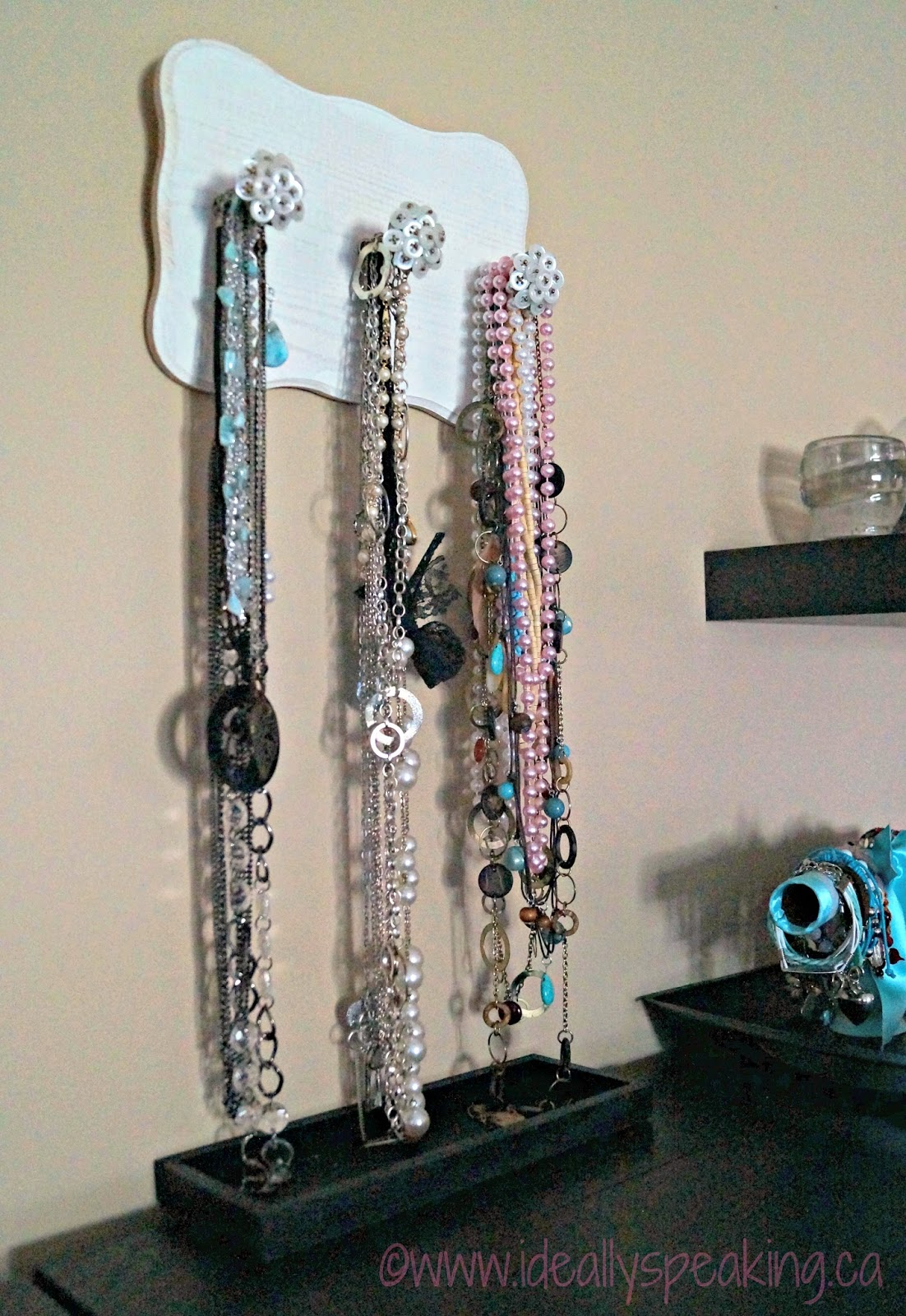 DIY necklace holder. Cute way to keep your jewelry on display. So dainty!
