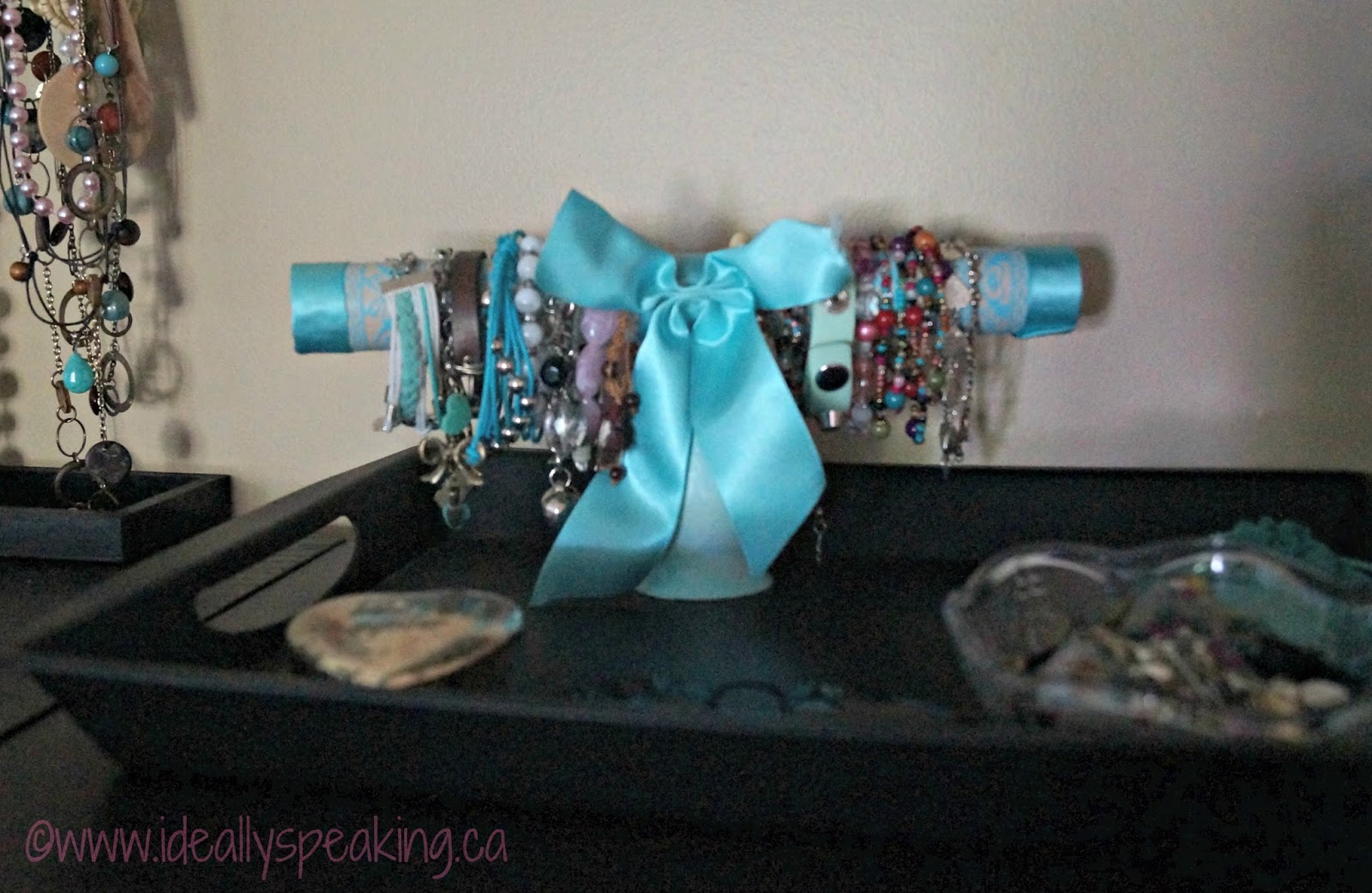 DIY bracelet holder using dollar store votive, paper towel roll & ribbon. So cute!