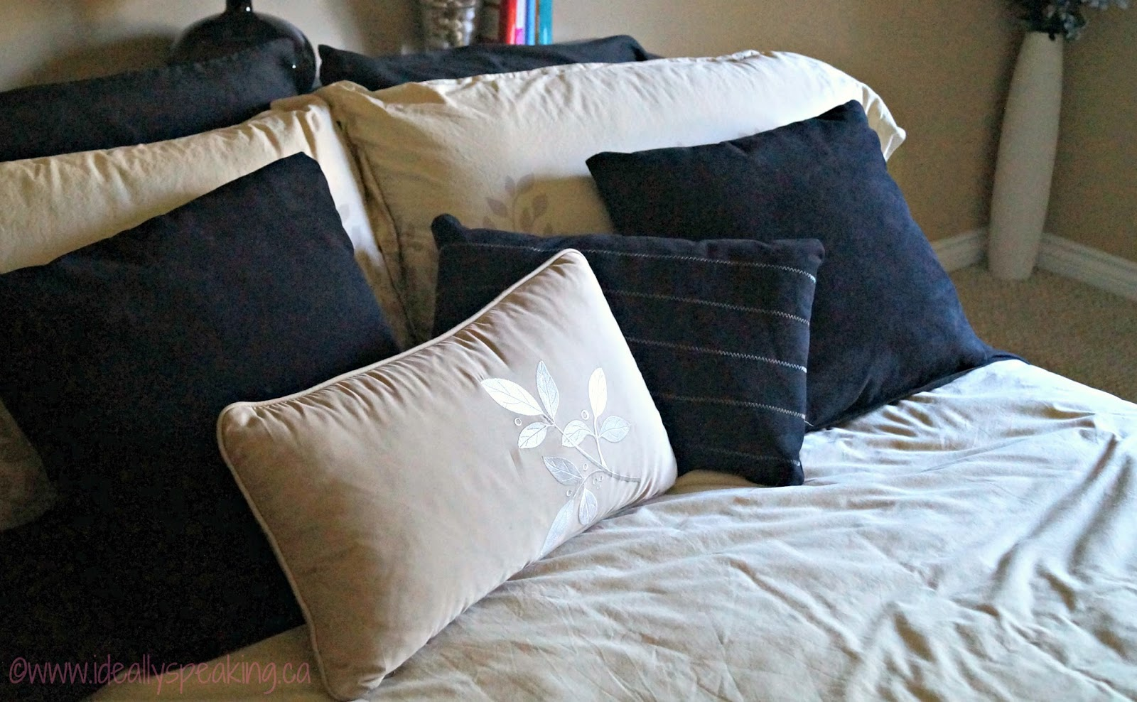Simple and beautiful bedding with lots of pillows.